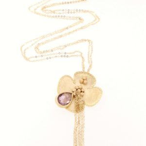 Yellow gold flower necklace with amethyst gemstone.